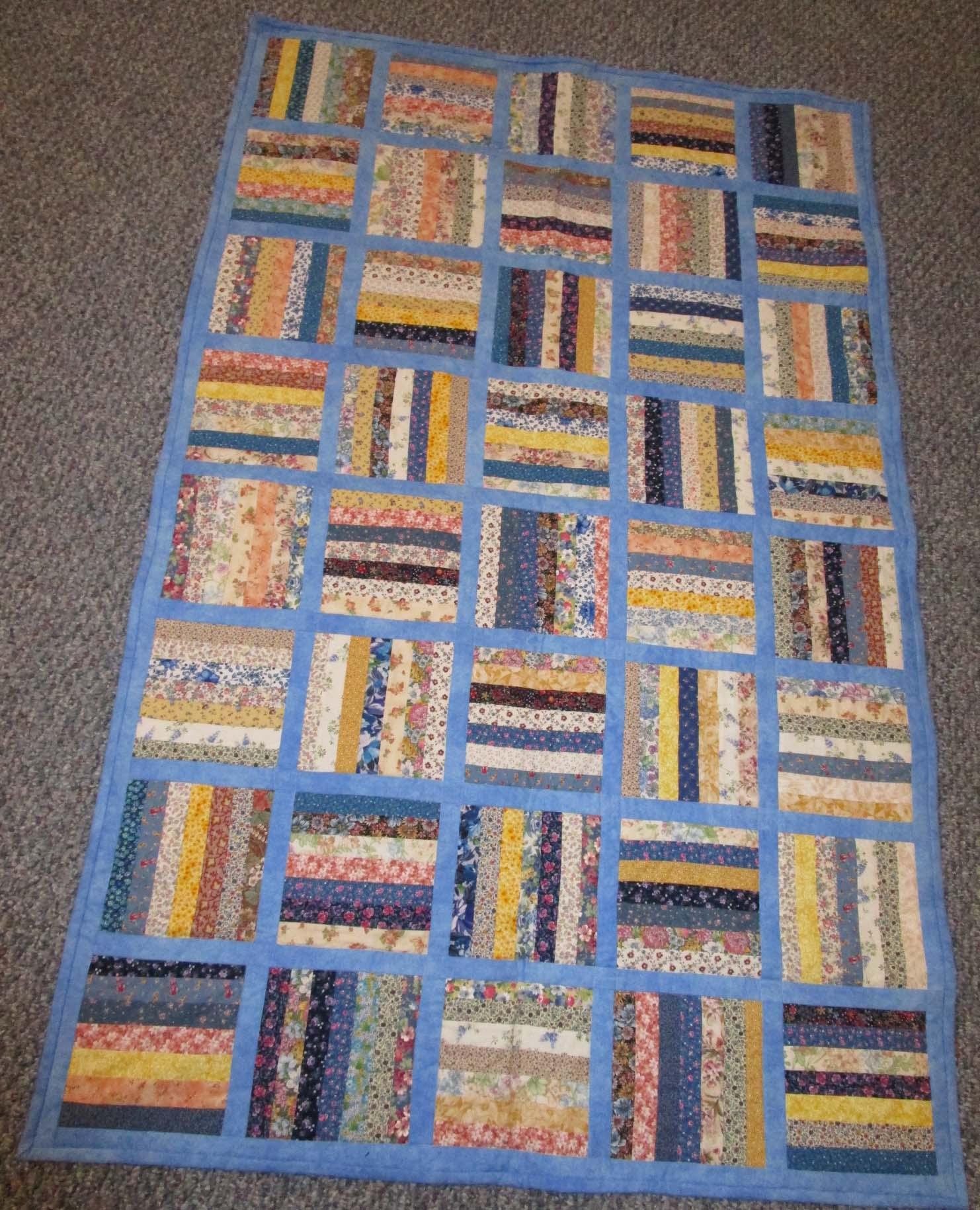 Strip Pieced SHP Quilt by Carol Eskola